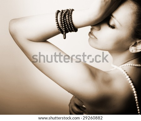 beautiful young woman with pearls - stock photo