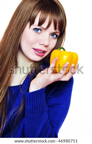beautiful young woman with pepper  over the white