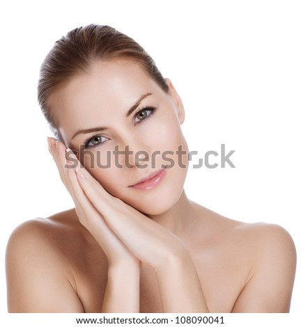 Beautiful young woman with perfect skin - stock photo