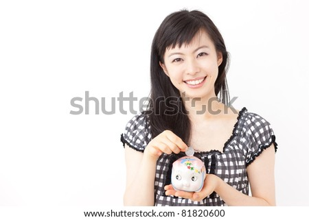 Beautiful young woman with piggy bank, isolated on white background