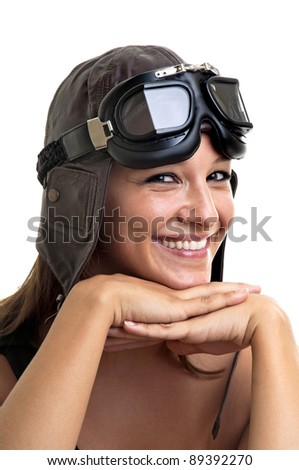 Beautiful young woman with pilot hat and goggles - stock photo