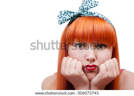 Beautiful young woman with pin-up make-up pout her lips - stock photo