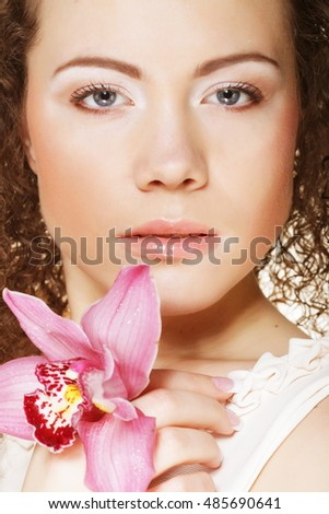 beautiful  young woman with pink orchid