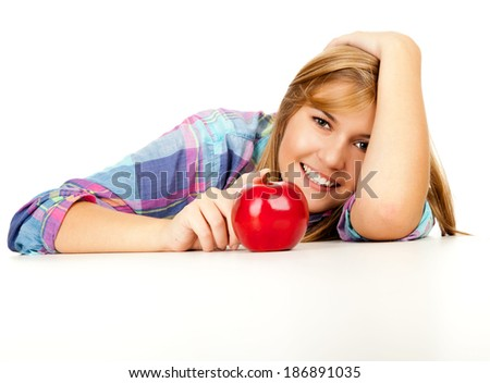 beautiful young woman with red apple, white background