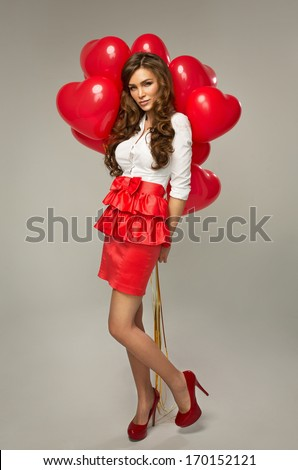 Beautiful young woman with red balloon heart shape for valentine's day