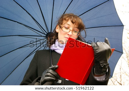 Beautiful young woman with red book