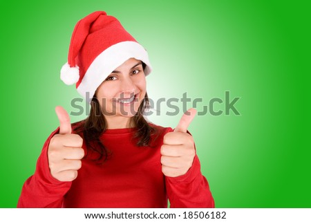 beautiful young woman with red Christmas hat over green background - stock photo