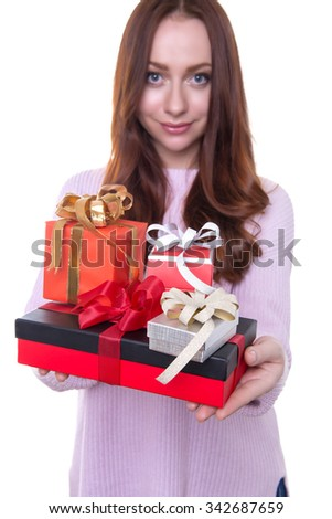 beautiful young woman with red hair posing cheerfully with presents for christmas isolated on white