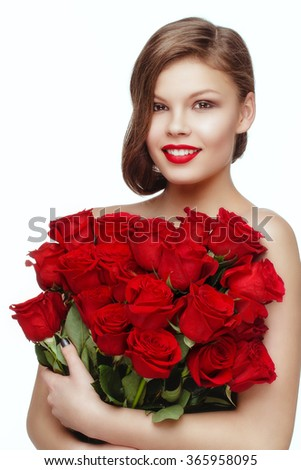 Beautiful young woman  with red roses posing isolated  in studio on white background.