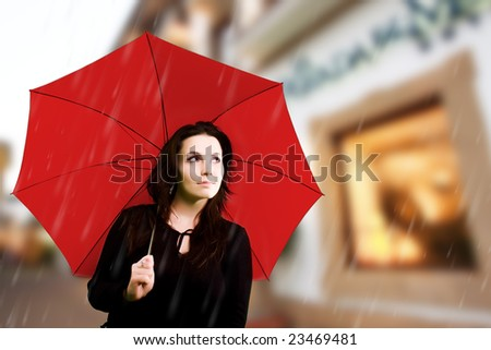 Beautiful young woman with red umbrella - stock photo
