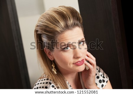 Beautiful young woman with retro style hairdo - stock photo