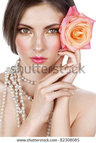 Beautiful young woman with rose - stock photo