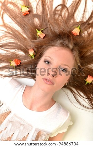 Beautiful young woman with rose flower isolated on white background