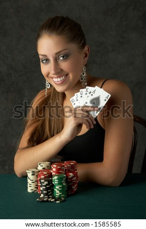 Beautiful Young Woman with Royal Flush - stock photo