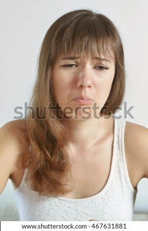 Beautiful young woman with sad face. Sad expression, sad emotion, despair, sadness