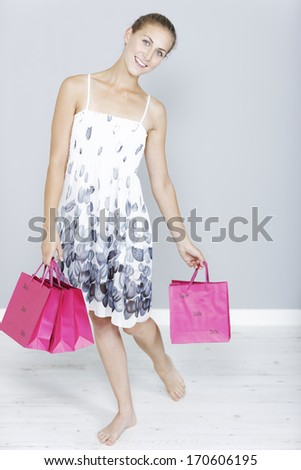 Beautiful young woman with sales shopping bags
