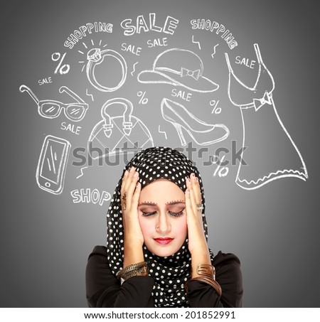 Beautiful young woman with scarf daydreaming over grey  background with hand on her face. Thinking about shopping - stock photo