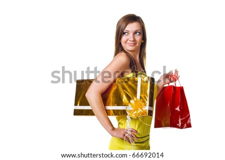 Beautiful young woman with shopping bags and gift. Isolated on white - stock photo