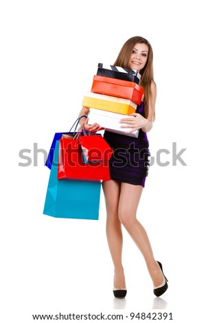 Beautiful young woman with shopping bags and gifts. isolated on white
