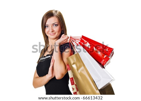 Beautiful young woman with shopping bags. Isolated on white - stock photo