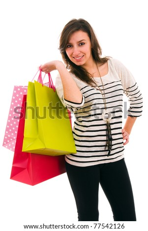Beautiful young woman with shopping bags, isolated on white - stock photo