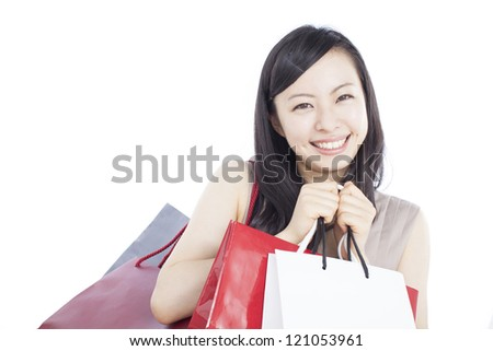 beautiful young woman with shopping bags isolated on white background - stock photo