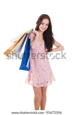 Beautiful young woman with shopping bags, isolated on white background