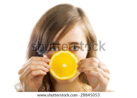 beautiful young woman with slice of orange
