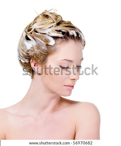Beautiful young woman with soaping head and closed eyes - isolated on white - stock photo