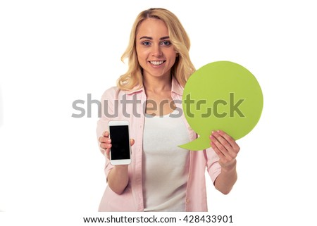 Beautiful young woman with speech bubble and smartphone is looking at camera and smiling, isolated on white background - stock photo