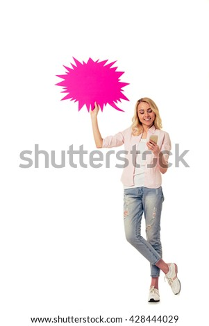 Beautiful young woman with speech bubble is using smartphone and smiling, isolated on white background - stock photo