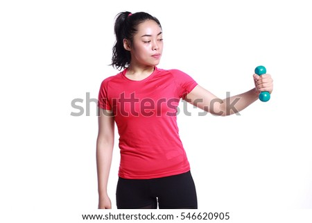 beautiful young woman with sports outfit working out with dumbell isolated in white