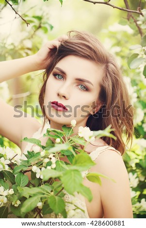 Beautiful Young Woman with Spring Blossom