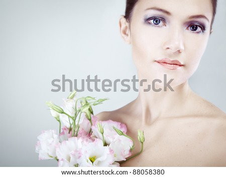beautiful young woman with spring flowers