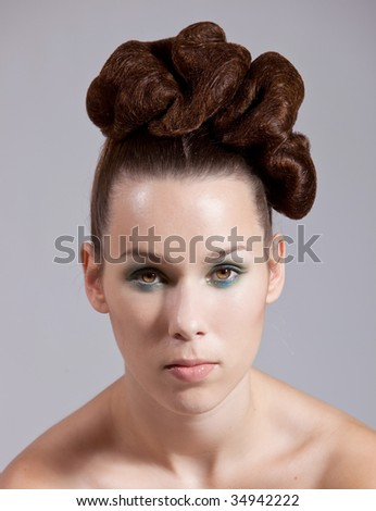 Beautiful young woman with stylish hair on grey background - stock photo