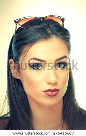 Beautiful young woman with sunglasses on a head - stock photo