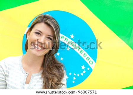 Beautiful young woman with the flag of Brazil - stock photo