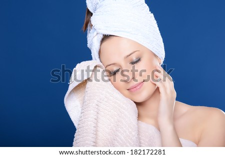 Beautiful young woman with towel - stock photo
