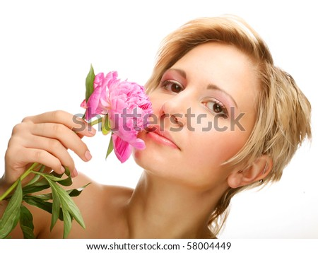 Beautiful young woman with tree-peony flower