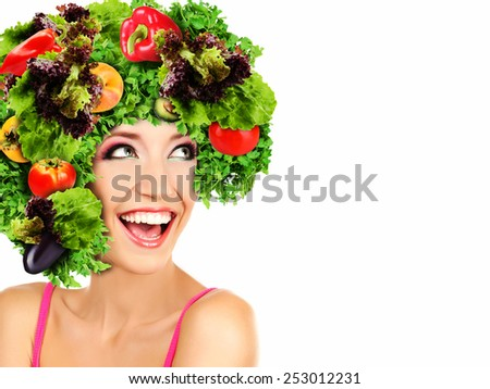Beautiful young woman with vegetable wig isolated on white - stock photo