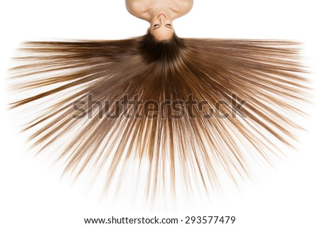 Beautiful young woman with very long natural hair lying on back. Isolalted over white background. - stock photo