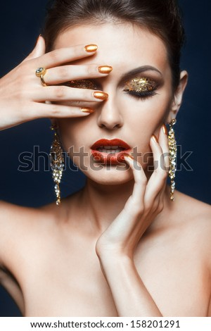 Beautiful young woman with vogue shining face makeup  - stock photo