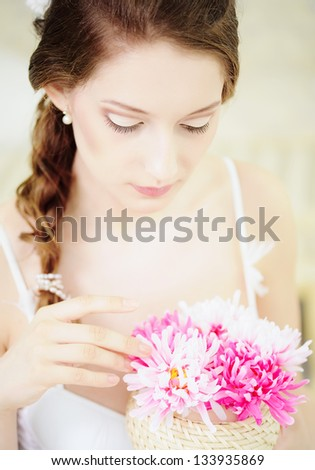 Beautiful young Woman with wedding bouqet of chrysanthemum
