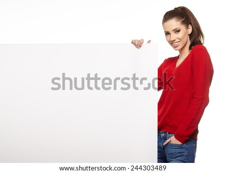 Beautiful young woman with white blank  board - stock photo