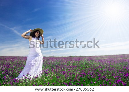 beautiful young woman with white dress in flower field - landscape orientation - stock photo