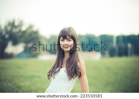 beautiful young woman with white dress in the city - stock photo