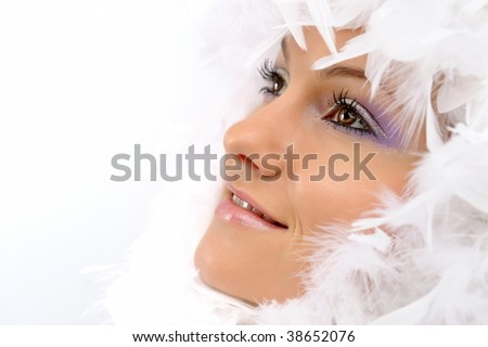 beautiful young woman with white feathers