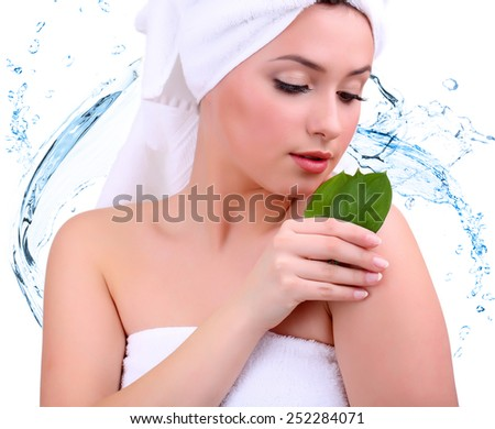 Beautiful young woman with with green leaves on abstract blue water splashing background - stock photo