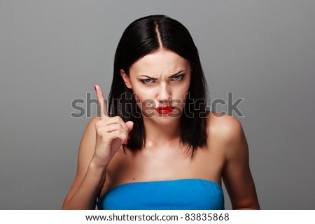 beautiful young woman with  with her finger up - stock photo