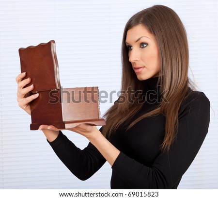 beautiful young woman with wooden jewelry box - stock photo